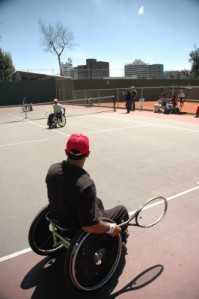 People playing tennis, using wheelchairs