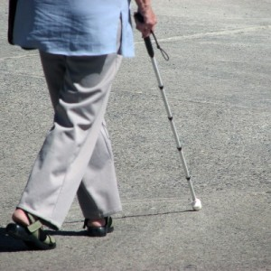 Lady walking with white cane