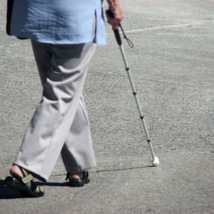 Lady walking with white cane