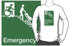 Accessible Means of Egress Icon Exit Sign Wheelchair Wheelie Running Man Symbol by Lee Wilson PWD Disability Evacuation Chair Adult T-shirt 1