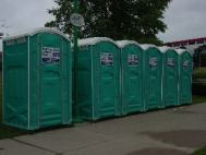 6 portable toilets along pathway