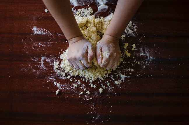 Person mixing pastry